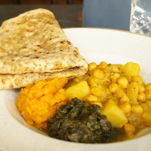 Ital Roti - dhal puri roti, sautéed pumpkin and spinach served with chickpea and potato curry