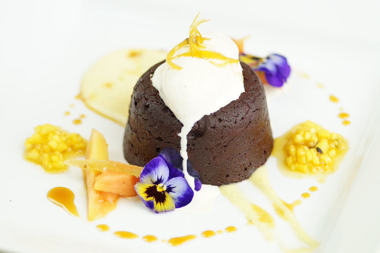 Cocolate fondant, crème anglaise with tropical fruits