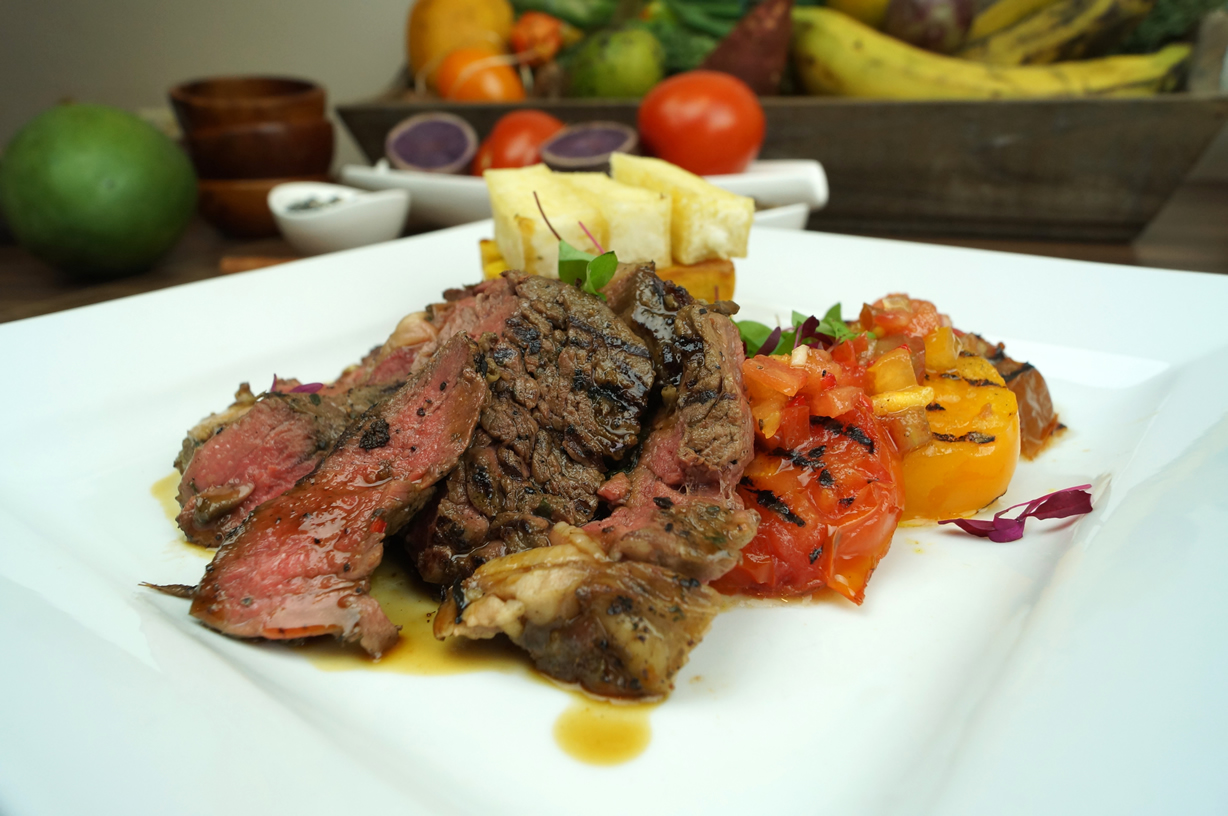Cumin Peppercorn Steak with trio of Cassava, Sweet Potato and Yam Chips, grilled tomatoes and Rum Jus